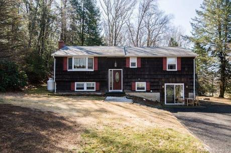 Single Family Home Sold in Danbury CT 06810. Ranch house near beach side waterfront with 3 car garage.