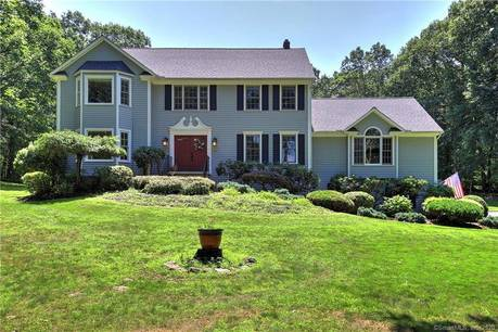 Single Family Home Sold in Monroe CT 06468. Colonial house near lake side waterfront with swimming pool and 2 car garage.