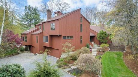 Single Family Home Sold in Trumbull CT 06611. Contemporary house near waterfront with swimming pool and 2 car garage.