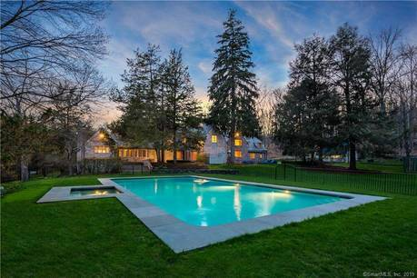 Single Family Home Sold in Weston CT 06883. Old colonial house near river side waterfront with swimming pool and 4 car garage.