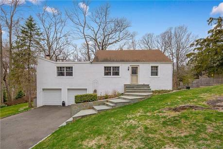 Single Family Home Sold in Norwalk CT 06850.  cape cod house near waterfront with 2 car garage.