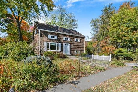 Single Family Home Sold in Greenwich CT 06878. Colonial house near river side waterfront.