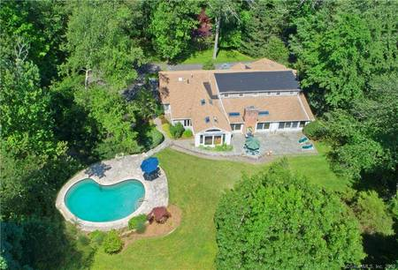 Single Family Home Sold in Greenwich CT 06831. Colonial house near waterfront with swimming pool and 2 car garage.