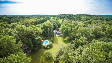 Single Family Home Sold in Weston CT 06883. Old colonial house near beach side waterfront with swimming pool and 2 car garage.