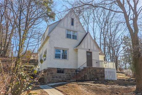 Single Family Home For Sale in Greenwich CT 06870. Old tudor cottage house near beach side waterfront with 1 car garage.