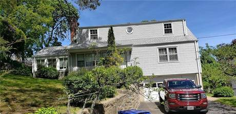 Single Family Home Sold in Norwalk CT 06854.  cape cod house near waterfront with 2 car garage.