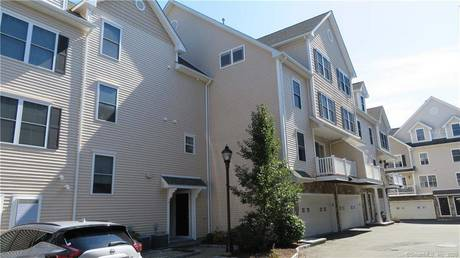 Condo Home For Sale in Stamford CT 06902.  townhouse near waterfront with 2 car garage.
