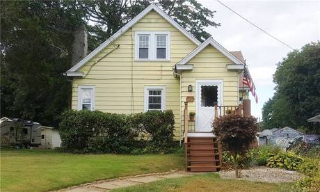 Single Family Home Sold in Stratford CT 06615. Old  cape cod house near waterfront with 2 car garage.