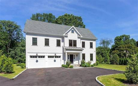 Single Family Home Sold in Westport CT 06880. Colonial house near river side waterfront with 2 car garage.