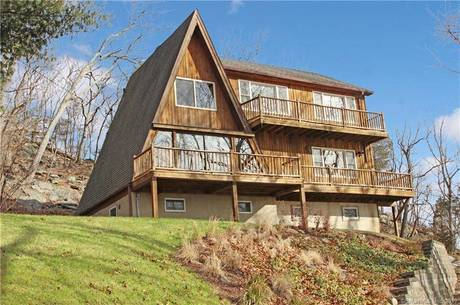 Single Family Home Sold in Danbury CT 06811. Contemporary, a-frame house near beach side waterfront.