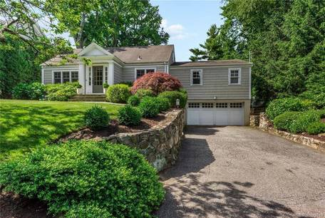 Single Family Home Sold in Greenwich CT 06878.  cape cod house near waterfront with 2 car garage.