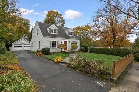 Single Family Home Sold in Norwalk CT 06851.  cape cod house near beach side waterfront with 2 car garage.
