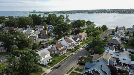 Single Family Home Sold in Norwalk CT 06855. Old  cape cod house near beach side waterfront with swimming pool and 2 car garage.