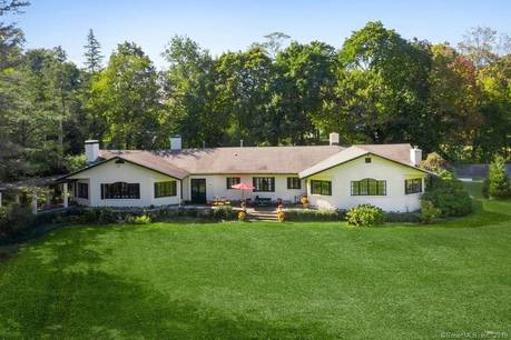 Luxury Single Family Home For Sale in Greenwich CT 06831. Old mediterranean house near waterfront with 2 car garage.