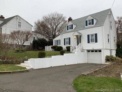 Single Family Home Sold in Greenwich CT 06830.  cape cod house near waterfront with 1 car garage.