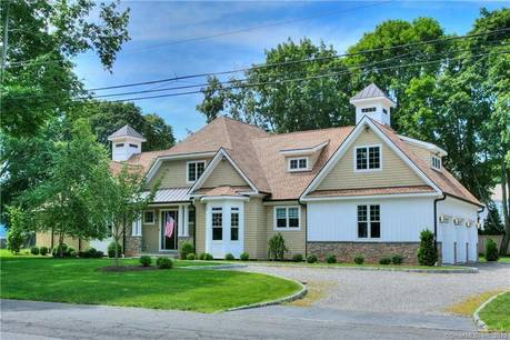 Single Family Home Sold in Westport CT 06880. Contemporary house near beach side waterfront with 3 car garage.