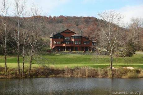 Single Family Home Sold in Sherman CT 06784. Contemporary house near waterfront with swimming pool and 3 car garage.
