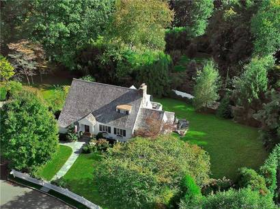 Single Family Home Sold in Greenwich CT 06830. Old colonial house near waterfront with 2 car garage.