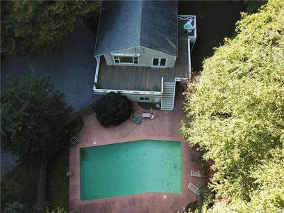 Single Family Home Sold in Wilton CT 06897. Ranch house near river side waterfront with swimming pool and 2 car garage.