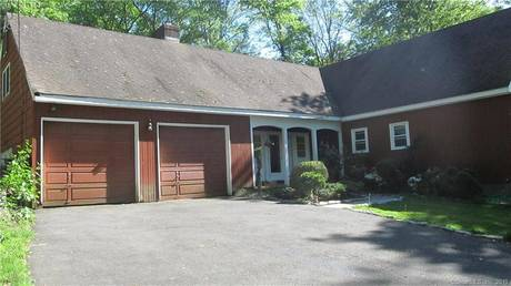 Single Family Home Sold in Stamford CT 06902.  cape cod house near waterfront with swimming pool and 2 car garage.