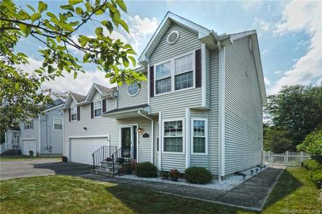 Single Family Home Sold in Bridgeport CT 06610. Colonial house near waterfront with swimming pool and 2 car garage.