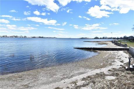 Single Family Home Sold in Norwalk CT 06854.  cape cod house near beach side waterfront with 2 car garage.