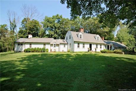 Single Family Home Sold in Redding CT 06896. Colonial cape cod house near waterfront with 3 car garage.