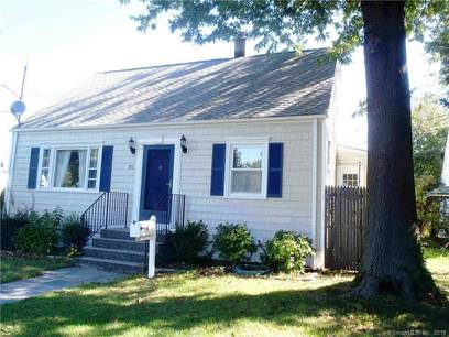 Single Family Home For Sale in Stamford CT 06902.  cape cod house near waterfront with 2 car garage.
