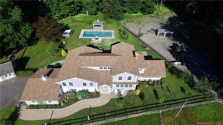 Single Family Home Sold in Fairfield CT 06824.  house near beach side waterfront with swimming pool and 3 car garage.