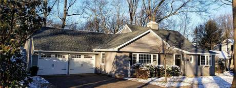 Single Family Home For Sale in Stratford CT 06614.  cape cod house near waterfront with 2 car garage.