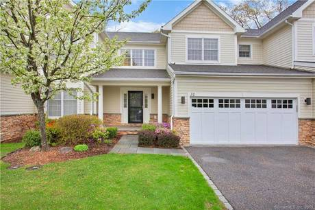 Condo Home For Sale in Ridgefield CT 06877.  townhouse near waterfront with 2 car garage.