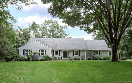 Single Family Home Sold in New Canaan CT 06840.  cape cod house near lake side waterfront with 2 car garage.