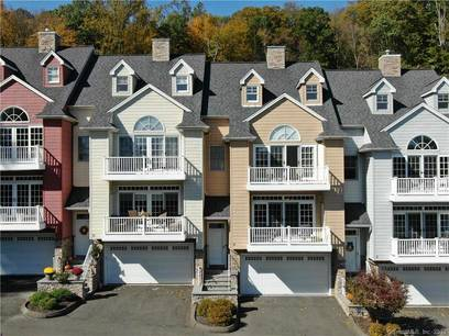 Condo Home For Sale in Shelton CT 06484.  townhouse near river side waterfront with 3 car garage.
