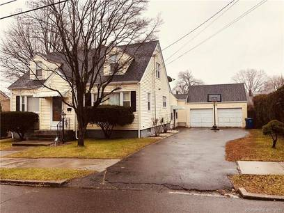 Single Family Home Sold in Bridgeport CT 06606. Colonial cape cod house near waterfront with 2 car garage.