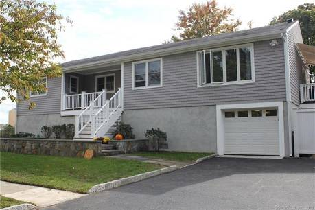 Single Family Home For Sale in Stamford CT 06902. Ranch house near beach side waterfront with 1 car garage.