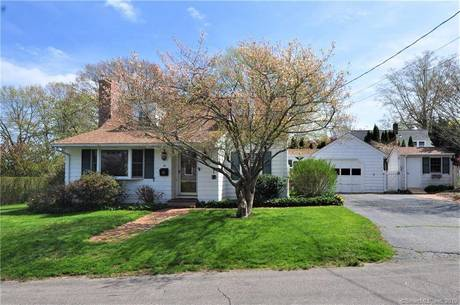 Single Family Home Sold in Fairfield CT 06824.  cape cod house near beach side waterfront with swimming pool and 1 car garage.