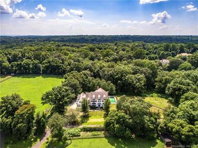 Single Family Home Sold in Fairfield CT 06890. Colonial house near beach side waterfront with swimming pool and 3 car garage.