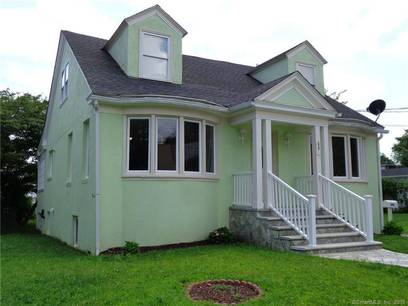 Single Family Home Sold in Bridgeport CT 06606.  cape cod house near waterfront with 2 car garage.