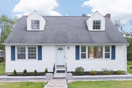 Single Family Home Sold in Brookfield CT 06804.  cape cod house near beach side waterfront with 1 car garage.