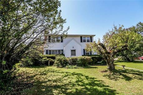 Single Family Home For Sale in Stamford CT 06906.  cape cod house near waterfront with 2 car garage.