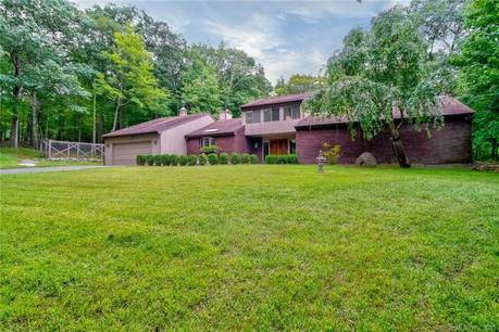 Single Family Home Sold in Ridgefield CT 06877. Contemporary, ranch house near beach side waterfront with 2 car garage.