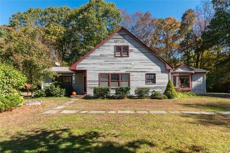 Single Family Home Sold in Newtown CT 06470.  cape cod house near waterfront with 3 car garage.