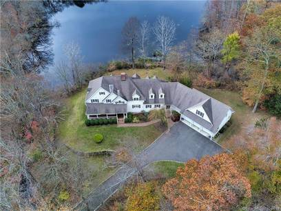 Single Family Home Sold in Wilton CT 06897. Colonial house near lake side waterfront with 3 car garage.