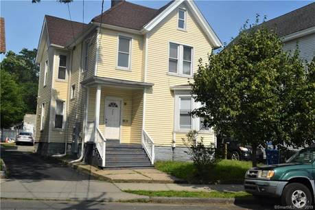 Multi Family Home Sold in Bridgeport CT 06605. Old  house near waterfront with 16 car garage.