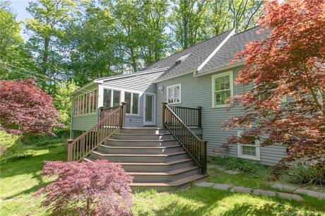 Single Family Home Sold in Monroe CT 06468.  cape cod house near waterfront with 2 car garage.