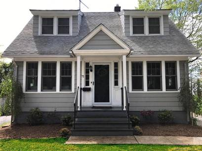Single Family Home Sold in Fairfield CT 06824. Old  cape cod house near waterfront with 2 car garage.