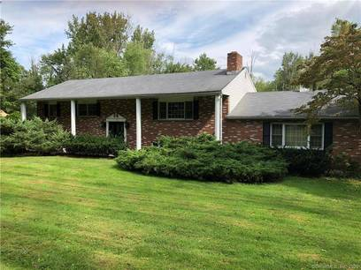 Single Family Home Sold in Brookfield CT 06804. Ranch house near river side waterfront with swimming pool and 2 car garage.