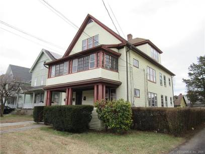 Multi Family Home Sold in Bridgeport CT 06604. Old  house near beach side waterfront with 3 car garage.