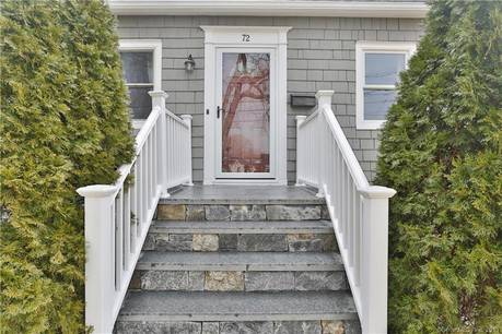 Single Family Home Sold in Norwalk CT 06851.  cape cod house near beach side waterfront with 1 car garage.