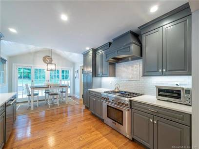 Single Family Home Sold in Wilton CT 06897. Ranch house near waterfront with 2 car garage.